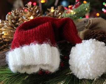 Hand Knitted Baby Santa Hat//0 to 6 months Santa Claus Hat//Baby Beanie//Cranberry Red Santa hat with fuzzy, frizzy brim//Christmas Baby hat
