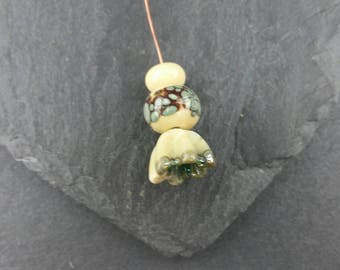 1 handmade lampwork glass headpin and 2 beads