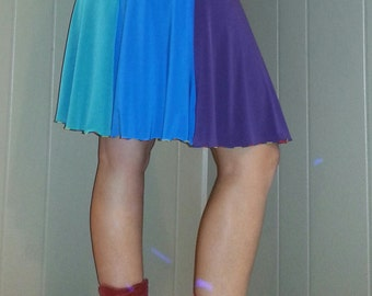 Small.  Rainbow Flourish Skirt. Red orange yellow green blue purple striped dancing skirt. Lightweight, fun and flowing.Colourful chakra