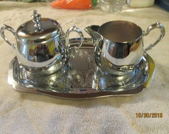 A Danny Wilson Original Sugar, Creamer & Tray Set Chrome