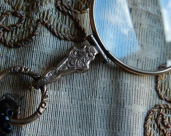 Antique gold tone metal quizzing glass pendant on French jet long beaded rope magnifying glass early to mid 19th century