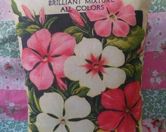Hand printed vintage seed packet cushion