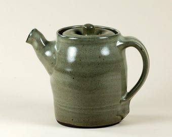 Black clay teapot with gray glaze