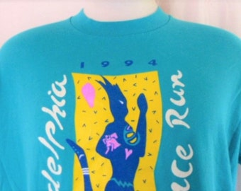 vintage 90's 1994 Philadelphia Distance Run Finisher light teal blue green graphic t-shirt white pink yellow abstract runner logo print XL
