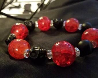 Black and red beaded skull bracelet
