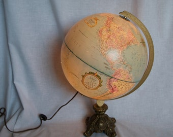 World Globe lamp...light up Replogle World Globe...12 inches in diameter…up cycled with ornate brass base.