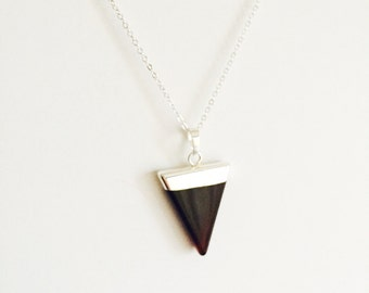 Black onyx triangle crystal necklace on a sterling silver chain.