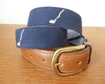 Men's navy blue embroidered belt with golf clubs, crooked golf club, Crooked Stick Golf Club logo