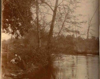 old french photo sepia: campagne chic- the lady with her little dog .