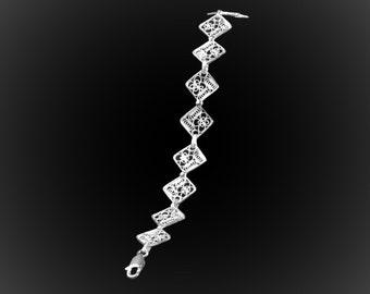 Bracelet four seasons in silver embroidery