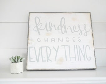 Kindness changes everything grey and white rustic wood sign