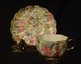 Chintz Demitasse tea cup and saucer.  Pink Floral Gold Trim.