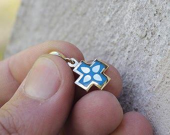 Golden cross with blue jewelry enamel.