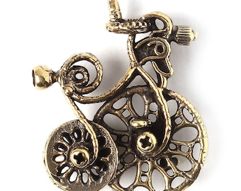 Fantasy brass jewelry findings bike charm pendant L3404(1). Handmade findings, bicycle, antique brass. Designed and made by Anna Bronze.