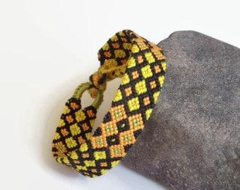"Macrame wrist cuff, thread friendship bracelet, unisex adult friendship cuff, string textile jewelry ""Harlequin"" 16 cm (6,3 inches)"