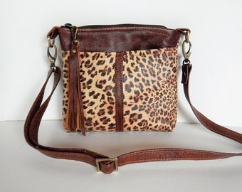 Cheetah leather crossbody bag.  Soft leather in cheetah print crossbody bag.