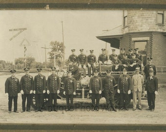 Firefighters with badges uniforms by fire engine truck antique photo