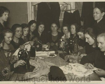 Women seamstresses with sewing machines antique photo
