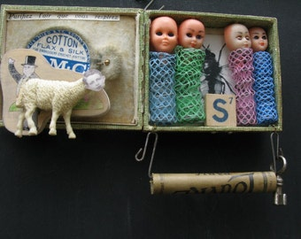 Little make-up box recycled art assemblage, art from trash with hair curlers.