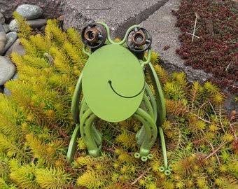 Welded garden art frog using salvaged materials.
