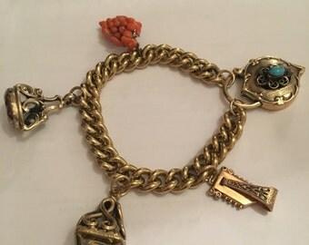 Beautiful charm bracekst with large heart lock