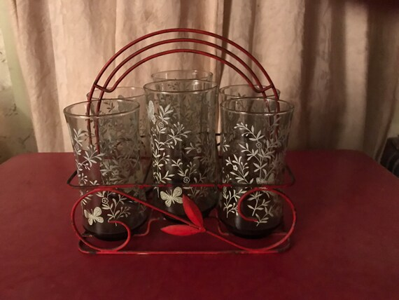 Drinking glass set in red metal carrier six glasses
