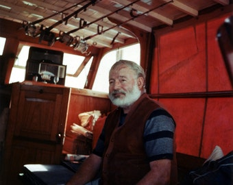 Ernesty Hemingway in the cabin of his boat Pilar, 1950