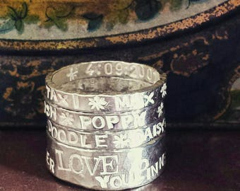 Silver ring bands with your own choice of words inside & out.