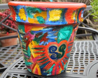 Beautiful terracotta pot painted with acrylic paint