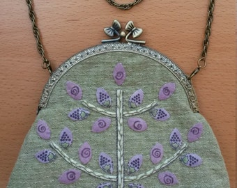 Purse with brass clasp and wear necklace