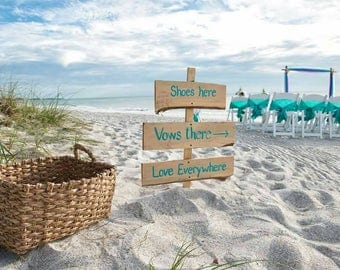 Shoes here vows there love everywhere beach wedding sign with stake