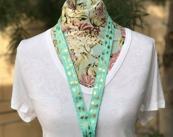 "18"" mint green ribbon lanyard with gold arrows"