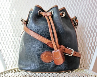 Vintage Dooney And Bourke Black And Tan All Weather Leather Small Drawstring Bucket Bag Shoulder Bag Made In USA