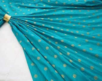Art silk jaquard with golden leaf pattern
