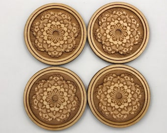 """A set of 4 laser engraved wood elements that measure  1.5"""" in diameter.  charms/jewelry/findings/laser/wood embellishments/craft"""