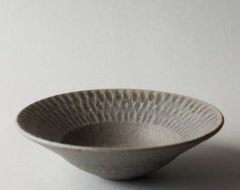 rusty grey faceted small rimmed bowl