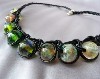 """Lampwork necklace,Lampwork beads on leather cord necklace,Green  necklace """"Parade of planets"""", , braided necklace with lampwork beads"""