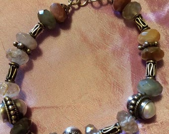"7 1/2"" Rutilated quartz and Bali sterling silver bracelet"