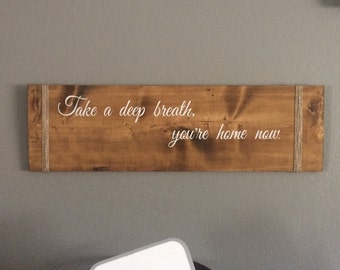 "Take a deep breath sign is 31"" long and 9"" wide. It has twine accents and two sawtooth hangers on the back."