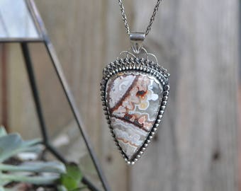 Large Mexican lace agate pendant