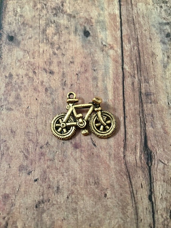 Bicycle charm 3d gold toned pewter 1 piece gold bicycle bicycle charm 3d gold toned pewter 1 piece gold bicycle pendant cycling charm bike rider charm cyclist pendant gold bike charm from aloadofball Gallery