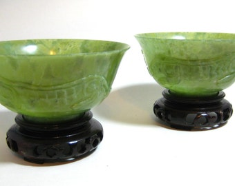 Pair of Vintage Chinese Spinach Jade Bowls with High Relief Reptile on Wood Base