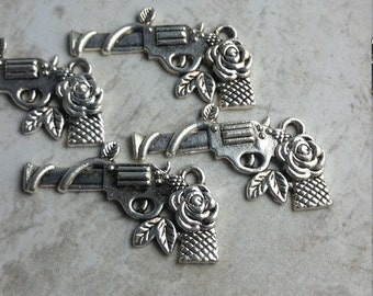 Gun with rose charms