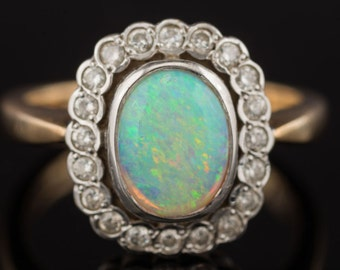 An Opal and Diamond Platinum Ring
