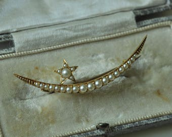 A Victorian Crescent Moon and Star Brooch