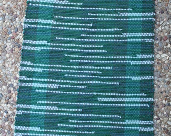 """Handwoven rug made with quality cotton materials. 20"""" x 31"""""""