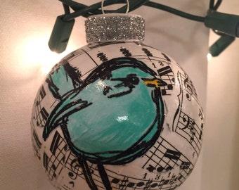 Blue bird on vintage sheet music round ball Chrstmas ornament