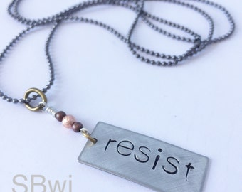 RESIST necklace in pewter with copper detail.