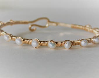 white freshwater pearls wire wrapped with 14ct gold filled wire on 14ct gold filled bracelet