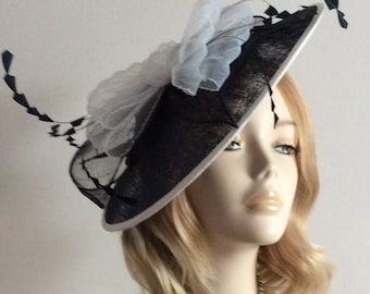 NAVY and WHITE FASCINATOR, Made of sinamay disc, and Crin, feathers, on a satin headband